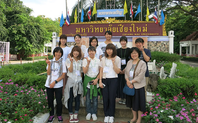 At the front gate of Chiang Mai University Campus